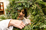 BETHLEHEM, CT. 06 December 2018-120618 -  Debbie McCarthy of Waterbury makes final adjustments to her wreath during the annual Wreath making social event at March Farms in Bethlehem on Thursday. Sue March the owner of March Farms says for everyone to sig up and get your spots early next year as they went very quickly this year. Bill Shettle Republican-American