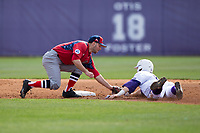 NJIT Highlanders shortstop Justin Etts (12) tags out Spencer Brown (26) of the High Point Panthers as he tries to steal second during game one of a double-header at Williard Stadium on February 18, 2017 in High Point, North Carolina.  The Panthers defeated the Highlanders 11-0.  (Brian Westerholt/Four Seam Images)