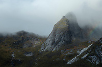 Clearing autumn storm over Munken mountain peak, Moskenesøy, Lofoten Islands, Norway