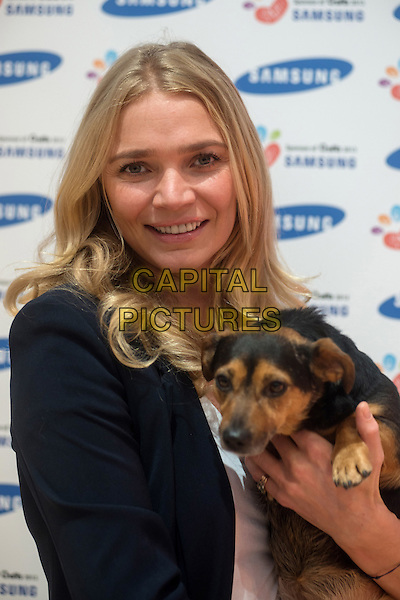Jodie Kidd, television personality and fashion model with her jack russell terrier at Crufts dog show at the NEC on March 7, 2013 in Birmingham.The annual Crufts dog show open their doors to dog lovers at Birmingham's NEC.The four-day show features more than 27,000 animals from around the world..half length black blazer dog animal hug.CAP/KOL.©Peter Kollanyi/Capital Pictures.