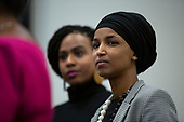 United States Representative Ayanna Pressley (Democrat of Massachusetts) and United States Representative Ilhan Omar (Democrat of Minnesota) listen to United States Representative Bonnie Watson Coleman (Democrat of New Jersey) speak during a press conference at the United States Capitol in Washington D.C., U.S., on Thursday, December 5, 2019. <br /> <br /> Photographer: Stefani Reynolds/CNP