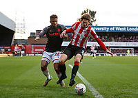 4th January 2020; Griffin Park, London, England; English FA Cup Football, Brentford FC versus Stoke City; Mads Bech Sorensen of Brentford is challenged by Tyrese Campbell of Stoke City - Strictly Editorial Use Only. No use with unauthorized audio, video, data, fixture lists, club/league logos or 'live' services. Online in-match use limited to 120 images, no video emulation. No use in betting, games or single club/league/player publications