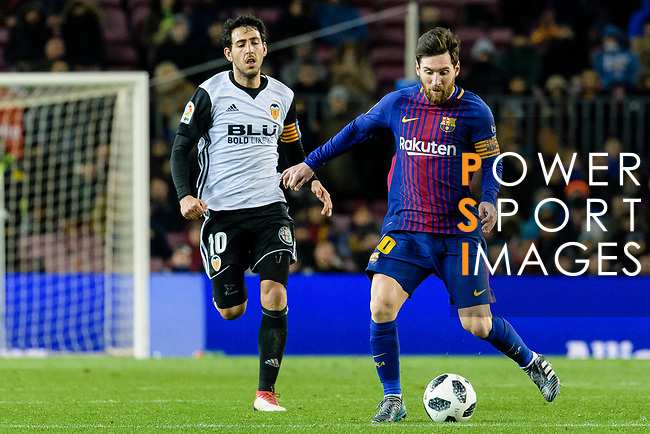 Lionel Messi of FC Barcelona (R) in action against Daniel Parejo Munoz of Valencia CF (L) during the Copa Del Rey 2017-18 match between FC Barcelona and Valencia CF at Camp Nou Stadium on 01 February 2018 in Barcelona, Spain. Photo by Vicens Gimenez / Power Sport Images