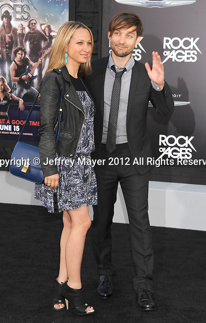 HOLLYWOOD, CA - JUNE 08: Tobey Maguire and Jennifer Meyer arrive at the 'Rock Of Ages' - Los Angeles Premiere at Grauman's Chinese Theatre on June 8, 2012 in Hollywood, California.