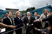 Left to right, South Korean Foreign Minister Yu Myung-hwan, left, United States Secretary of State Hillary Rodham Clinton, U.S. Secretary of Defense Robert Gates and South Korean Defense Minister Kim Tae-young speak to members of the press outside the T2 buildings in Panmunjom, the demilitarized zone that separates the two Koreas since the Korean War, north of Seoul, South Korea, Wednesday, July 21, 2010. .Mandatory Credit: Cherie Cullen - DoD via CNP
