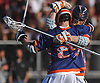 Jack Orlando #19 of Manhasset, right, and Edward Arnold #24 celebrate as the final seconds tick down on their team's 7-4 win over host Garden City High School in 133rd Woodstick Classic on Saturday, April 28, 2018.