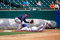 Pawtucket Red Sox third baseman Mike Olt (2) waits to receive a throw as Michael De La Cruz (43) slides into third base during a game against the Buffalo Bisons on June 28, 2018 at Coca-Cola Field in Buffalo, New York.  Buffalo defeated Pawtucket 8-1.  (Mike Janes/Four Seam Images)