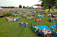 "Event photography of the Charlotte Symphony performing in a free outdoor concert June 17, 2012 at Duke Energy's McGuire Nuclear Station EnergyExplorium in Cornelius, NC. The symphony orchestra performed a ""musical travels"" program."