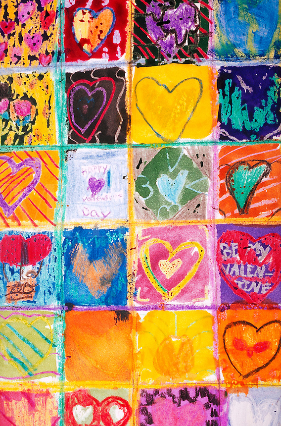 A mural of children's drawings of hearts.