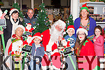 Launching Christmas in Killorglin in Boyles hardware on Monday evening were l-r: Geraldine O'Sullivan, Charlie Brosnan, Santa Claus, Ben Brosnan, Grainne Eccles, Hayley O'Sullivan. Back row: Orla Eccles, Mike Kenny and Colette O'Sullivan