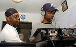 Actor/Comedian Chris Rock checks out DJ equipment of  Hurricane Katrina evacuee Ronald Williams,at left, while on a visit to the Bonita House in Houston,Texas Thursday Sept. 29,2005.
