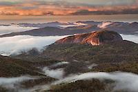 Sunrise and mountain mist around Looking Glass Rock, Blue Ridge Mountains from Blue Ridge Parkway near Brevard, North Carolina
