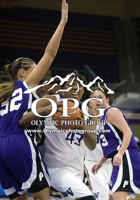 17 March 2010:  Washington Huskies center #43 Regina Rogers drives past Portland's #32 Sarah Kliewer. Washington won 75-44 over Portland at the Bank of America Arena in Seattle, WA.