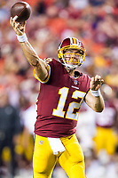Landover, MD - August 16, 2018: Washington Redskins quarterback Colt McCoy (12) throws a pass downfield during preseason game between the New York Jets and Washington Redskins at FedEx Field in Landover, MD. (Photo by Phillip Peters/Media Images International)