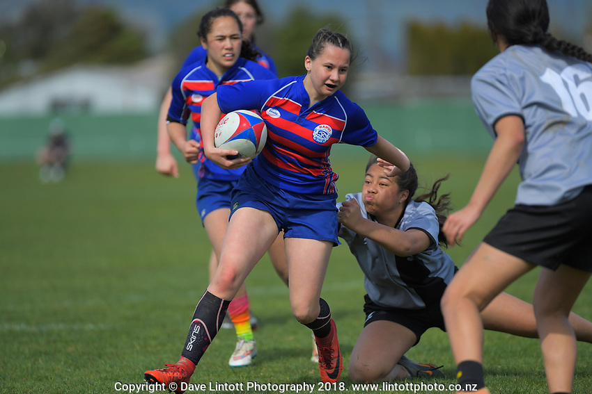 Action from the 2019 Hurricanes Youth Council Under-15 Girls' Rugby Tournament match between St Mary's and Rahui at Playford Park in Levin, New Zealand on Tuesday, 3 September 2018. Photo: Dave Lintott / lintottphoto.co.nz