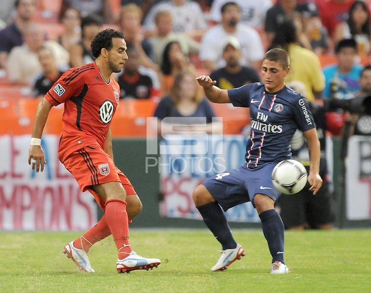 D.C. United forward Dwayne De Rosario (7) goes against Paris St. Germain defender Milan Bisevac (4)  D.C. United tied Paris St. Germain 1-1 at RFK Stadium, Saturday 28, 2012.