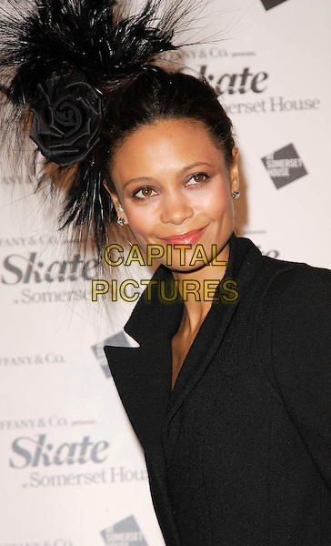 THANDIE NEWTON.At Somerset House Ice Rink VIP Launch Party, London, England, November 20th 2007..portrait headshot black hat feathers rose flower .CAP/ROS.©Steve Ross/Capital Pictures