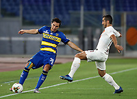 Parma's Matteo Darmian, left, is challenged by Roma s Henrikh Mkhitaryan during the Italian Serie A football match between Roma and Parma at Rome's Olympic stadium, July 8, 2020.<br /> UPDATE IMAGES PRESS/Isabella Bonotto
