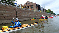 NWA Democrat-Gazette/FLIP PUTTHOFF <br /> The flotilla exits a lock on the Mississippi River. Paddlers went through two locks on the Mississippi on their way to Hannibal, Mo.