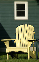 A chair sits in front of a cottage Saturday, July 1, 2006, in Lakeside, Ohio.