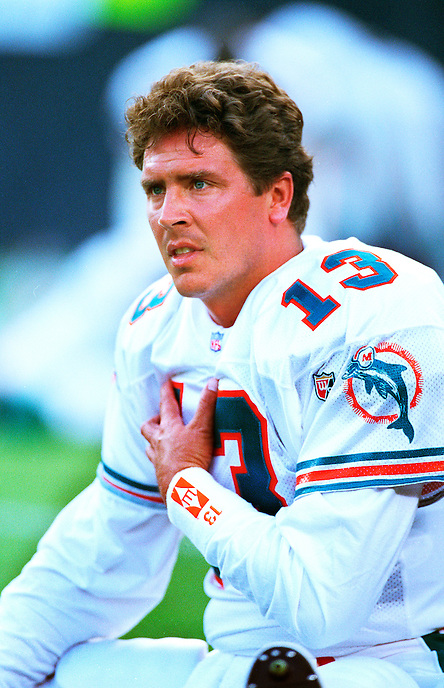 Miami Dolphins quarterback Dan Marino stretches before a football game in 1995 at Jack Murphy Stadium in San Diego, California..Marino is a Hall of Fame quarterback who became one of the most prolific quarterbacks in league history, holding or having held almost every major NFL passing record. Despite never being on a Super Bowl-winning team, he is recognized as one of the greatest quarterbacks in American football history