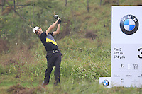 Felipe Aguilar (CHI) tees off the 3rd tee during Thursday's Round 1 of the 2014 BMW Masters held at Lake Malaren, Shanghai, China 30th October 2014.<br /> Picture: Eoin Clarke www.golffile.ie