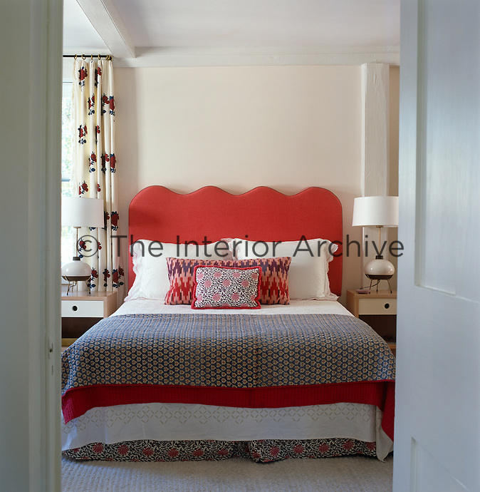Glimpse through an open door into a guest bedroom