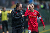 Seattle, Washington - Saturday May 14, 2016: Portland Thorns FC head coach Mark Parsons talks with midfielder Allie Long (10) during the first half of a match at Memorial Stadium on Saturday May 14, 2016 in Seattle, Washington. The match ended in a 1-1 draw