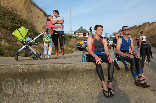 27 JUL 2013 - CROMER, GBR - Competitors wait for the start of The Anglian Triathlon swim from West Runton to Cromer, North Norfolk, Great Britain (PHOTO COPYRIGHT © 2013 NIGEL FARROW, ALL RIGHTS RESERVED)