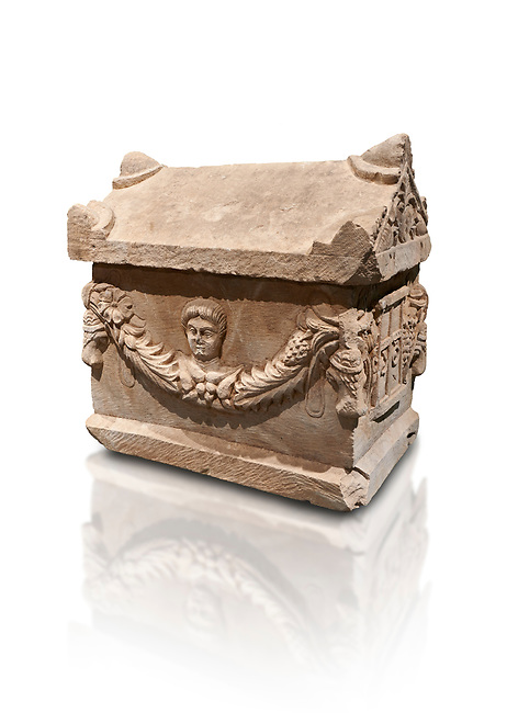 Roman relief decorated garland osthotek cremation container, 2nd century AD. An ostothec is used to preserve the ashes and bones of the dead bodies after their cremation, takes its form from a small sarcophagus. This ostothec is a miniature example of the garland sarcophagus. Adana Archaeology Museum, Turkey. Against a white background
