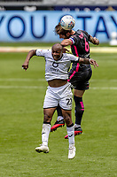 Leeds United's Liam Cooper competing with Swansea City's Andre Ayew (right) <br /> <br /> Photographer Andrew Kearns/CameraSport<br /> <br /> The EFL Sky Bet Championship - Swansea City v Leeds United - Sunday 12th July 2020 - Liberty Stadium - Swansea<br /> <br /> World Copyright © 2020 CameraSport. All rights reserved. 43 Linden Ave. Countesthorpe. Leicester. England. LE8 5PG - Tel: +44 (0) 116 277 4147 - admin@camerasport.com - www.camerasport.com