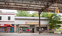 A Salvation Army Thrift Store under the elevated train at the Freeman Street subway station in the Bronx borough of New York is seen on Saturday, July 26, 2014.  (© Richard B. Levine)