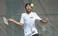 STAFF PHOTO ANTHONY REYES &bull; @NWATONYR<br /> Sriker Chikkala, of Bentonville, keeps his eyes on the ball during a volley in his match against Sameer Kamath of Fayetteville, during the 7A-West Conference boys tennis tournament Wednesday, Oct. 8, 2014 at the Springdale Har-Ber tennis courts.