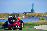 Brooks Koepka's (USA) girlfriend Jena Sims and Dustin Johnson's (USA) fiancee Paulina Gretzky ride on a cart on 14 during round 2 Four-Ball of the 2017 President's Cup, Liberty National Golf Club, Jersey City, New Jersey, USA. 9/29/2017.<br /> Picture: Golffile | Ken Murray<br /> <br /> All photo usage must carry mandatory copyright credit (&copy; Golffile | Ken Murray)