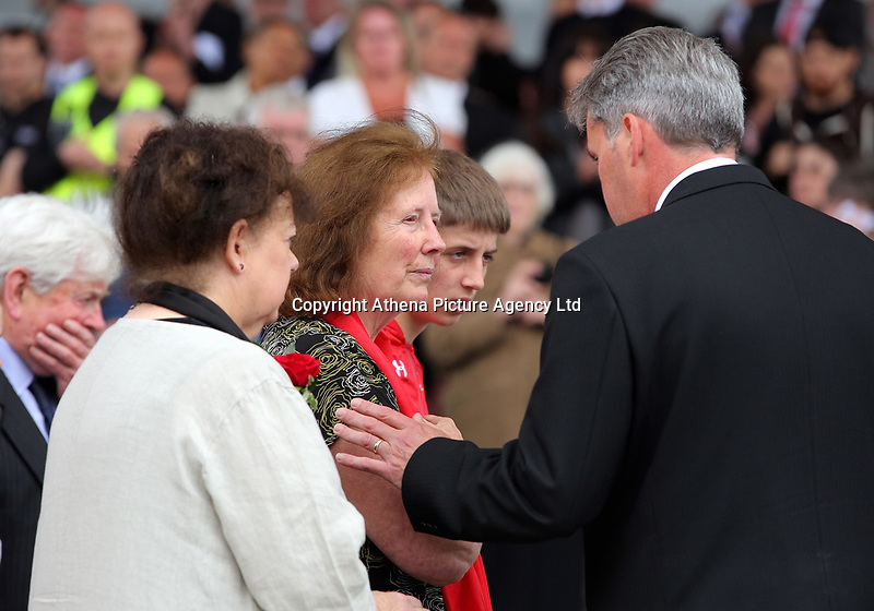 """Pictured: Rhofdri Morgan's wife Julie (C) after the service. Wednesday 31 May 2017<br />Re: The funeral for former first minister Rhodri Morgan has taken place in the Senedd in Cardiff Bay.<br />The ceremony, which was open to the public, was conducted by humanist celebrant Lorraine Barrett.<br />She said the event was """"a celebration of his life through words, poetry and music"""".<br />Mr Morgan, who died earlier in May aged 77, served as the Welsh Assembly's first minister from 2000 to 2009.<br />He was credited with bringing stability to the fledgling assembly during his years in charge.<br />It is understood Mr Morgan had been out cycling near his home when he died."""