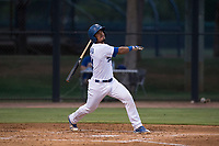 AZL Dodgers catcher Juan Zabala (54) follows through on his swing during an Arizona League game against the AZL White Sox at Camelback Ranch on July 3, 2018 in Glendale, Arizona. The AZL Dodgers defeated the AZL White Sox by a score of 10-5. (Zachary Lucy/Four Seam Images)
