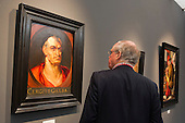 London, England. 15 October 2014. A visitor of Frieze Masters looks a the painting Portrait of Emperor Servius Sulpicius Galba (3 BC–69 AD)', c. 1598, by Peter Paul Rubens at the fine art fair Frieze Masters 2014 in Regent's Park, London. Photo: Bettina Strenske