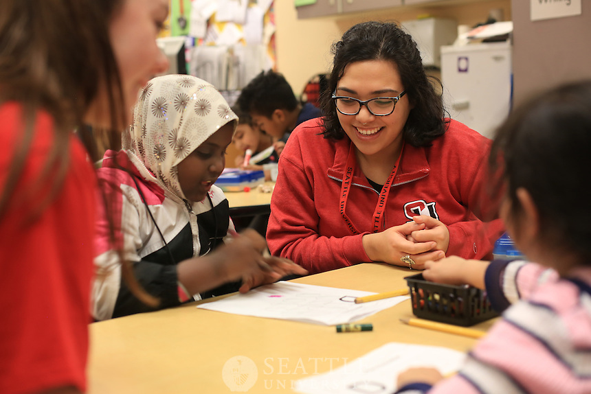 January 27th, 2016-  Seattle University Youth Initiative at Bailey Gatzert Elementary School. <br /> <br /> Seattle University students work with Bailey Gatzert Elementary School students during the After School program as part of the SUYI.