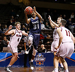 SIOUX FALLS, SD: MARCH 22: Caleb Waitsman #23 of Colorado Mines drives between Bellarmine defenders Ben Weyer #4 and Brent Bach #15 during the Men's Division II Basketball Championship Tournament on March 22, 2017 at the Sanford Pentagon in Sioux Falls, SD. (Photo by Dick Carlson/Inertia)