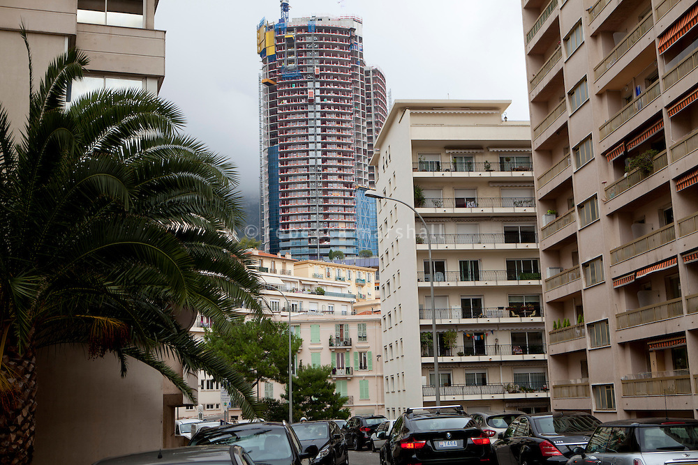View of the Tour Odéon (centre) under construction, seen from Boulevard du Maréchal Leclerc, the road that marks the border between France (left) and Monaco (right), Beausoleil, France, 18 October 2013.