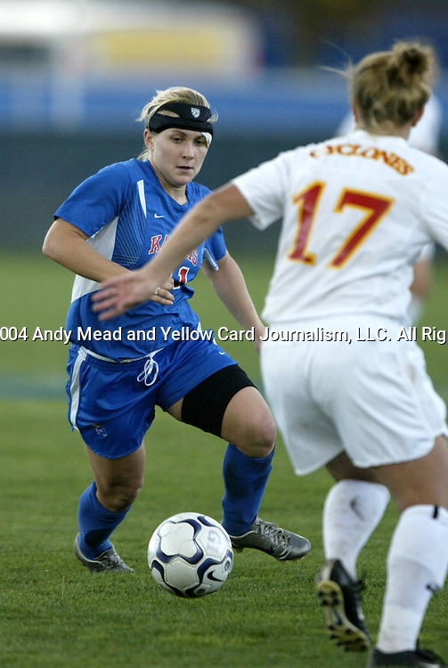 29 October 2004: Caroline Smith (left) takes on Meghan Schlenker (17). Kansas defeated Iowa State 4-0 in Lawrence, KS to clinch the Big XII Conference Womens Soccer Championship..