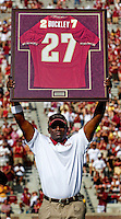 TALLAHASSEE, FL 9/3/11-FSU-ULM FB090311 CH-Florida State football great Terrell Buckley hoists his jersey after it was retired during a half time ceremony in the University of Louisiana at Monroe game Saturday at Doak Campbell Stadium in Tallahassee. .COLIN HACKLEY PHOTO