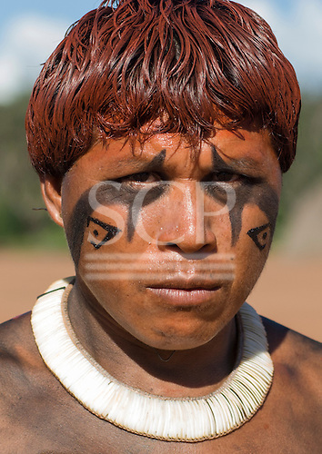 Xingu Indigenous Park, Mato Grosso State, Brazil. Aldeia Waura. Payapakuma Waura with beautiful shell necklace looking angry.