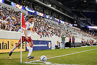 Sinisa Ubiparipovic (8) of the New York Red Bulls takes a corner kick. The Columbus Crew defeated the New York Red Bulls 3-1 during a Major League Soccer (MLS) match at Red Bull Arena in Harrison, NJ, on May 20, 2010.