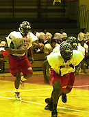 Washington, DC - October 17, 2002 -- Coach Craig Jefferies watches as his Dunbar High Crimson Tide Football team conducts practice at the school in Washington, DC on 17 October, 2002.  The team is forced to practice indoors due to the sniper scare in the DC Metro Area.<br /> Credit: Ron Sachs / CNP<br /> (RESTRICTION: NO New York or New Jersey Newspapers or newspapers within a 75 mile radius of New York City)