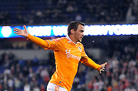 Cam Weaver (15) of the Houston Dynamo celebrates after scoring the game tying goal. The New York Red Bulls  and the Houston Dynamo played to a 1-1 tie during a Major League Soccer (MLS) match at Red Bull Arena in Harrison, NJ, on April 02, 2011.