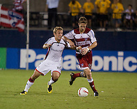 New England Revolution forward Taylor Twellman (20) and FC Dallas defender Clarence Goodson (11) battle for the ball.  New England Revolution defeated FC Dallas 3-2 to capture the 2007 Lamar Hunt U.S. Open Cup at Pizza Hut Park in Frisco, TX on October 3, 2007.