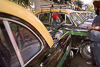 Sikh taxi drivers with their fleet of Ambassador cars at a taxi rank just off the Grand Trunk Road in Delhi.