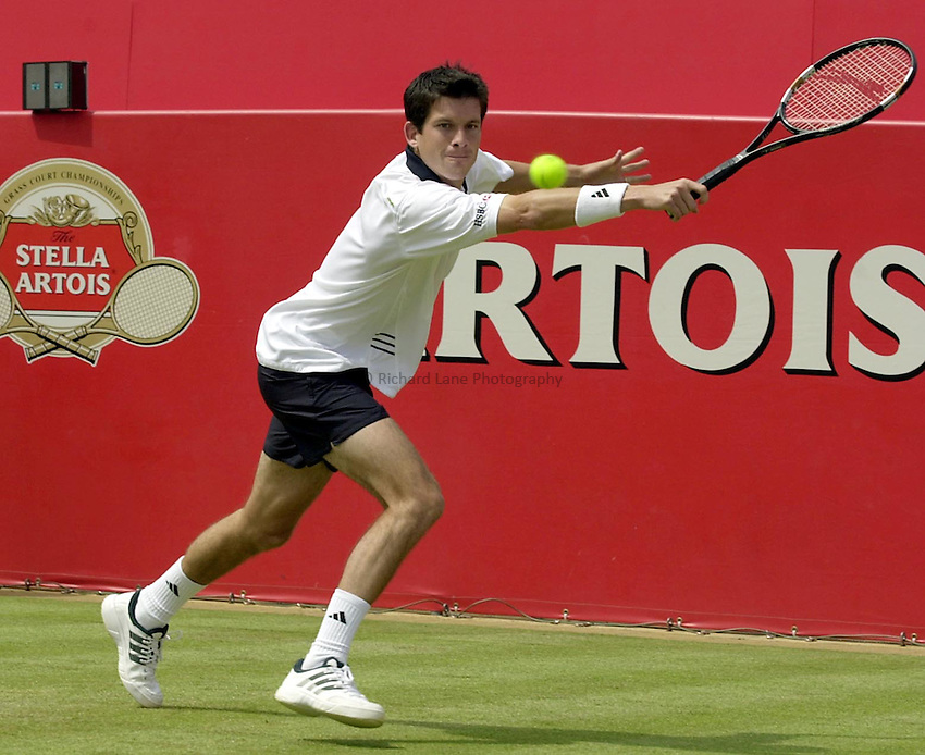 Photo:Ken Brown .11/06/2001. .Stella Artois Championship 2001 .Tim Henman stretches to get a ball back from Wayne Arthurs..