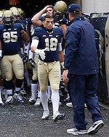 Jarred Holley shakes hands with head coach Paul Chryst on Senior Day. The Pitt Panthers defeat the Rutgers Scarlet Knights 27-6 on Saturday, November 24, 2012 at Heinz Field , Pittsburgh, PA.